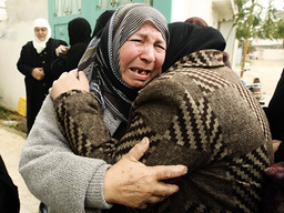 Palestinian relatives of Hamas gunman mourn during his funeral in refugee camp in southern Gaza Strip