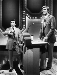 BLANK CHECK, from left: host Art James with contestant, 1975.