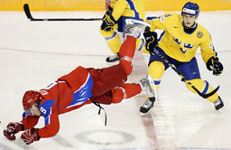 Russia's Klopov is pushed down to the ice by Sweden's Torp at the IIHF U20 World Junior Hockey Championships in Ottawa