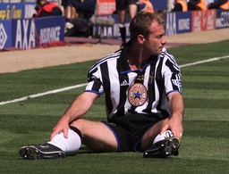 NEWCASTLE'S SHEARER SIST ON THE GROUND IN FRUSTRATION