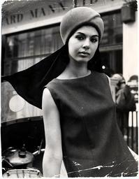 Linda Keith Model Wearing A Peach Bloom Helmet With Black Fly-away Scarf.