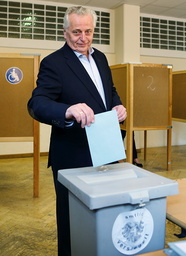 Presidential candidate Rudolf Hundstorfer of the social democrats SPOe casts his vote during presidential election in Vienna
