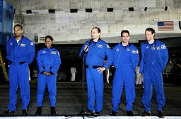Crewmembers of the space shuttle Discovery attend a news conference at the Kennedy Space Center in Cape Canaveral