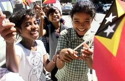 EAST TIMORESE CHILDREN WAVE THEIR NEW COUNTRY'S FLAGS IN DILI