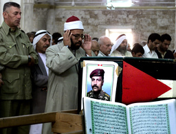 PALESTINIANS PRAY AT THE BODY OF NAHEAD AL JOJO IN GAZA