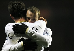 Manchester United's Rooney hugs Neville after Ronaldo scores second goal against Aston Villa during their English Premier League match in Birmingham