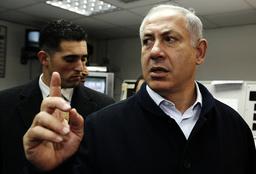 Likud party leader Netanyahu gestures during visit to Ashdod