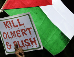 A member of hardliner Islamic Defenders Front (FPI) holds up an anti-Israel banner during a protest against Israel's air offensive in the Gaza Strip, in front of U.S. embassy, in Jakarta
