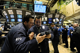Traders confer as the New York Stock Exchange closes in New York