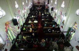Christians pray at Catholic church during Christmas celebrations in Srinagar
