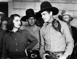 BULLETS FOR RUSTLERS, front from left: Lorna Gray, Charles Starrett, 1940