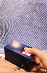 A FINGER PRINT IS DETECTED BY AN ELECTRONIC DEVICE IN BERLIN