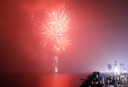 Spectators watch a fireworks display during a New Year's Eve countdown along Manila bay
