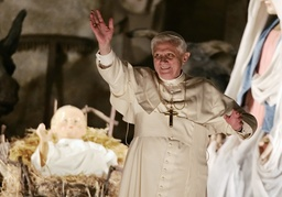 Pope Benedict XVI waves to faithful after blessing the traditional Crib in St Peter's square at the end of the Te Deum prayer in St Peter's Basilica at the Vatican