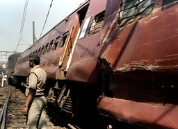 DERAILED CARRAIGES LIE ON THEIR SIDE IN BOMBAY