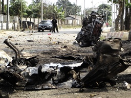 The remains of a vehicle used in a car bomb explosion lie on a street at Port Harcourt, Nigeria