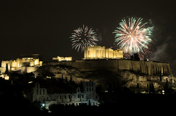 Fireworks explode over the temple of the Parthenon atop the hill of the Acropolis during New Year's Day celebrations in Athens
