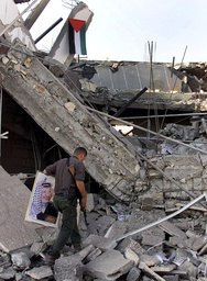 PALESTINIAN POLICEMAN INSPECTS A DAMAGE TO POLICE STATION IN RAMALLAH