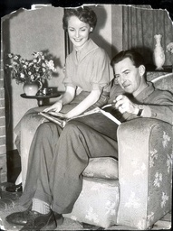 Actress And Singer Petula Clark Pictured At Her Home With Her Father Leslie Clark Looking At A Scrapbook.