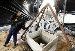 Palestinians look at destroyed tunnel near Egyptian border with Gaza