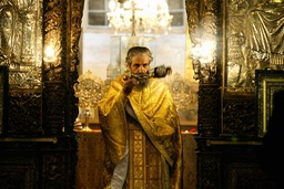 An Eastern Orthodox priest during a mass at the Church of Nativity in Bethlehem