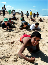 YOUNG HAMAS PALESTINIAN BOYS TRAIN ON BEACH IN GAZA STRIP
