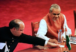 PAKISTANI PRIME MINISTER SHARIF PASSES A COASTER TO HIS INDIAN COUNTERPART VAJPAYEE