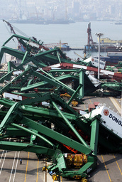 GIANT CONTAINER CRANES DESTROYED BY TYPHOON MAEMI IN THE SOUTHERN PORT CITY OF PUSAN