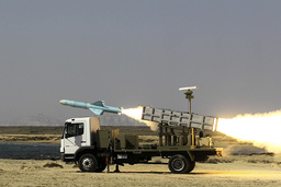 An Iranian long-range shore-to-sea missile called Nasr is launched during the Velayat-90 war game on the Sea of Oman's shore near the Strait of Hormuz in southern Iran