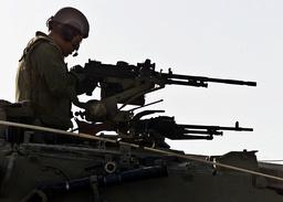 ISRAELI SOLDIER MANS A MACHINE ON A TANK NEAR BETHLEHEM
