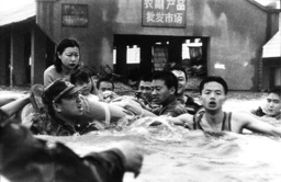 CHINESE SOLDIERS RESCUE RESIDENTS FROM A FLOODED MARKET