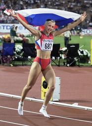 A JUBILANT LEBEDEVA OF RUSSIA CELEBRATES AFTER WINNING WOMENS TRIPLE JUMP FINAL