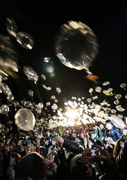 People fly balloons to celebrate New Year at the Zojo-ji Buddhist temple in Tokyo