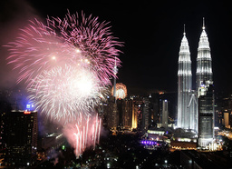 Fireworks explode near the Petronas Twin Towers to celebrate the New Year in Kuala Lumpur