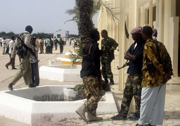 Islamic courts fighters stand at Mogadishu's international airport