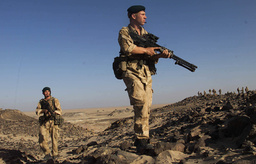 ROYAL MARINES PATROL THE OMANI DESERT DUIRNG OPERATION SWIFT SWORD