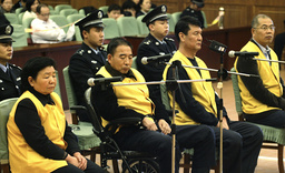 Four former executives of Sanlu Group stand on trial at Shijiazhuang Intermediate People's Court
