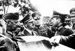 ADOLF HITLER CONFERS WITH HIS OFFICERS DURING THE FIGHTING OF POLAND, 1939.
