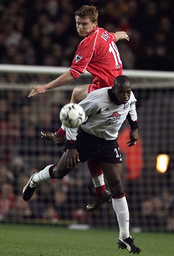 LIVERPOOL'S RIISE JUMPS FOR THE BALL WITH FULHAM'S BOA MORTE IN THE ENGLISH PREMIER LEAGUE MATCH AT ANFIELD