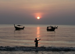 A boy plays at Khao Lak beach in Phang Nga province