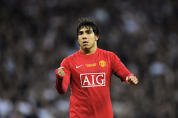 Manchester United's Tevez celebrates scoring a penalty during their English League Cup final soccer match against Tottenham Hotspur in London