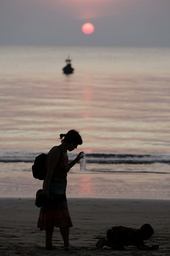A tourist from Germany plays with her son at Khao Lak beach in Phang Nga province