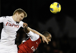 Fulham's Riise challenges Arsenal's Walcott during their English Premier League soccer match in London