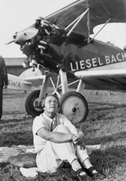 Liesel Bach in front of her airplane, 1936