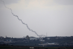 A trail of smoke is seen after the launch of rocket from the Gaza Strip