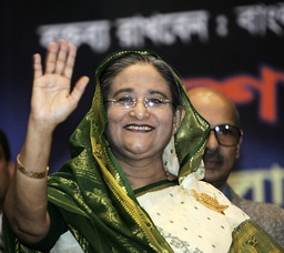 Bangladesh Awami League President and former PM Hasina waves as she arrives at news conference in Dhaka