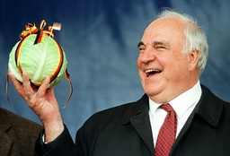 GERMAN CHANCELLOR HELMUT KOHL HOLDS CABBAGE AFTER SPEECH IN BUESUM