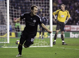 Chelsea's Robben celebrates after scoring during their English Premier League soccer match against Wigan Athletic in Wigan
