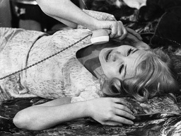 Carroll Baker Actress Is Seen Here Lying On Her Bed On The Telephone.