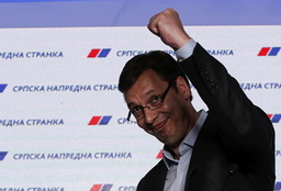 Serbian Prime Minister and leader of the Serbian Progressive Party Vucic reacts after elections in Belgrade
